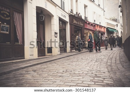 PARIS, FRANCE - OCTOBER 9, 2014:  Street scene along the Montmartre district of Paris with vintage filter effect.  - stock photo