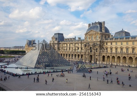 PARIS, FRANCE- October 8 2014: The large glass pyramid and the main courtyard of the Louvre Museum on October 8, 2014.  - stock photo