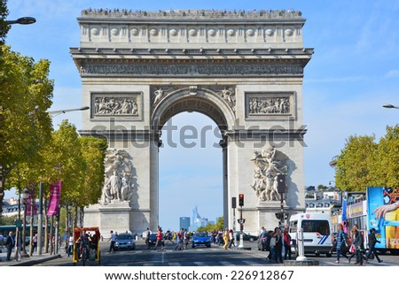 PARIS, FRANCE OCTOBER 19: The Triumphal Arch de l Etoile ( arc de triomphe) . The monument was designed by Jean Chalgrin in 1806 in Paris, France on October 19, 2014  - stock photo
