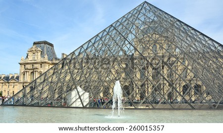 PARIS, FRANCE OCTOBER 20, 2014: View of Inverted Pyramid (architect Pei Cobb Freed) in Louvre Museum at sunset. With 8.8 million annual visitors, Louvre is consistently most visited museum worldwide.  - stock photo