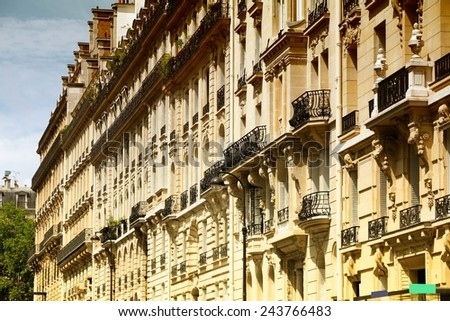 Paris, France - old apartment buildings street. Windows and balconies. Filtered style colors. - stock photo