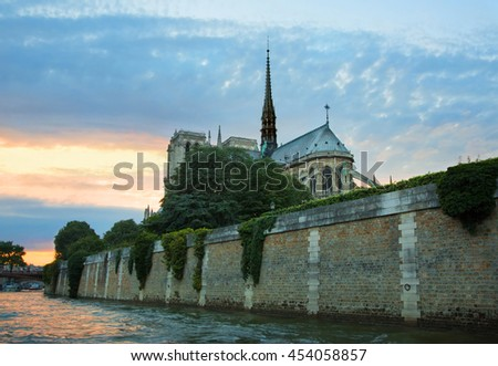 PARIS, FRANCE, Picturesque view from the river Seine to the Notre Dame de Paris at sunset. Cityscape - stock photo