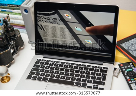 PARIS, FRANCE - SEP 10, 2015: Apple Computers website on MacBook Pro Retina in a creative room environment showcasing the newly announced iPad Pro - stock photo