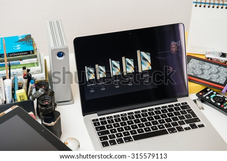 PARIS, FRANCE - SEP 10, 2015: Apple Computers website on MacBook Pro Retina in a creative room environment showcasing the newly iPad pro by Philip Shiller and their prices - stock photo