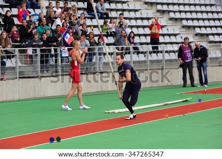 PARIS, FRANCE - SEP.13: Lavillenie Renaud on DecaNation International Outdoor Games on September 13, 2015 in Paris, France. He is Olympic champion and World record holder jump pole vault with 6m16 - stock photo