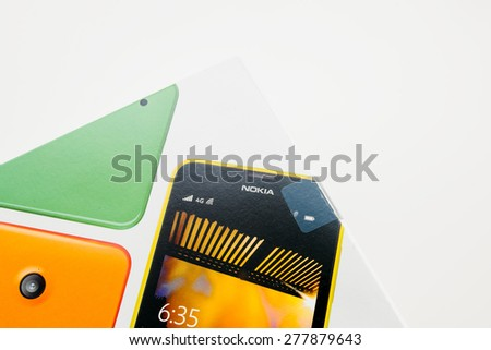 PARIS, FRANCE - SEP 110, 2014: Microsoft Lumia Nokia phone box on white background. Microsoft Lumia (previously the Nokia Lumia Series) is a line of mobile devices designed and marketed by Microsoft - stock photo