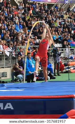 PARIS, FRANCE - SEP.13: Sam Kendricks win pole vault on DecaNation International Outdoor Games on September 13, 2015 in Paris, France. Sam Kendricks Is an athlete US, specialist in pole vaulting - stock photo