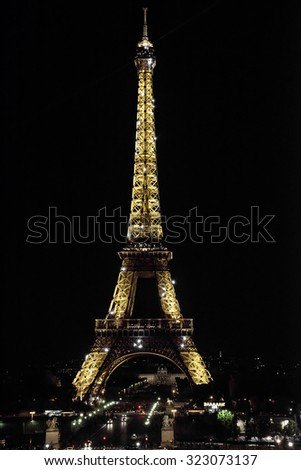 PARIS, FRANCE - SEPTEMBER 24: Ceremonial lighting of the Eiffel tower on September 24, 2015 in Paris, France. The Eiffel tower is the most visited monument of France. - stock photo