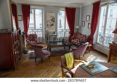 PARIS, FRANCE - SEPTEMBER 8, 2014: Classic living room in a old apartment in Paris  - stock photo