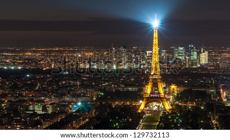 PARIS, FRANCE - SEPTEMBER 29: Eiffel Tower on September 29, 2012 in Paris. It was erected in 1889 and has become both a global cultural icon of France and the world. - stock photo