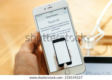 PARIS, FRANCE - SEPTEMBER 20, 2014: Hand holding a Apple iPhone 6 Plus displaying the new Touch Id App with  fingerprint option during the sales launch of the latest Apple Inc. smartphones - stock photo