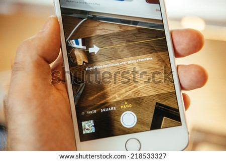 PARIS, FRANCE - SEPTEMBER 20, 2014: Hand holding a iPhone 6 Plus displaying the Camera app and Panorama Button during the sales launch of the latest Apple Inc. smartphones at the Apple store - stock photo