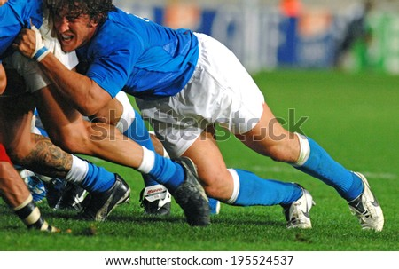 PARIS, FRANCE-SEPTEMBER 20, 2007:  italian player Mauro Bergamasco pushes in scrum, during the match Portugal vs Italy at the Rugby World Cup, France 2007, in Paris. - stock photo