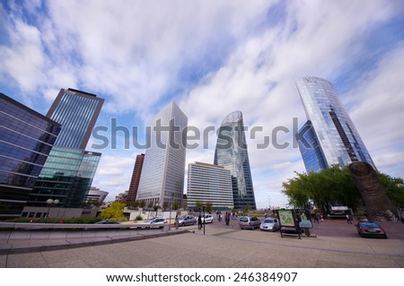 PARIS, FRANCE - SEPTEMBER 21, 2011: La Defense is the largest business district in Europe with 560 ha area, 72 glass and steel buildings and skyscrapers. wide view of La Defense buildings.  - stock photo