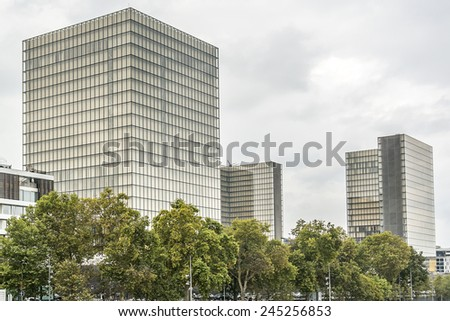 PARIS, FRANCE - SEPTEMBER 14, 2013: Modern Bibliotheque nationale de France (BNF Francois Mitterand) is the National Library of France, located in Paris on the banks of river Seine. - stock photo