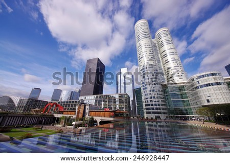 PARIS, FRANCE - SEPTEMBER 21, 2011: Office buildings in La Defense district, large modern business centre in the western part of Paris, France. Photo taken on September 21, 2011 in La Defense, Paris.  - stock photo