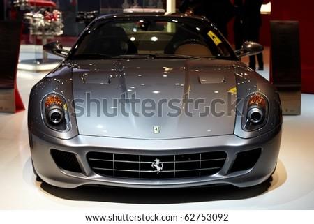 PARIS, FRANCE - SEPTEMBER 30: Paris Motor Show on September 30, 2010 in Paris, showing Ferrari 599 GTB Fiorano, front view - stock photo