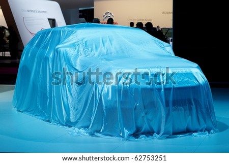 PARIS, FRANCE - SEPTEMBER 30: Paris Motor Show on September 30, 2010, Range Rover Evoque covered before presentation - stock photo