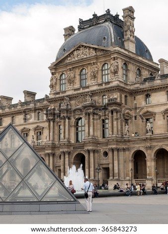 PARIS, FRANCE - SEPTEMBER 11, 2014: Paris - The Louvre Museum. Louvre is one of the biggest Museum in the world, receiving more than 8 million visitors each year.  - stock photo