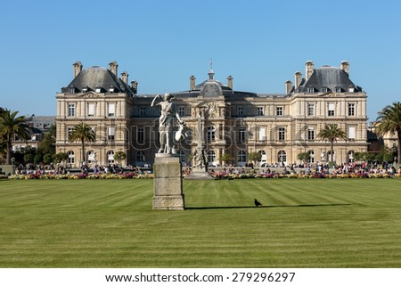 PARIS, FRANCE - SEPTEMBER 12, 2014: People relax in Luxembourg Gardens in Paris, France. Luxembourg area is popular among tourists in Paris, the most visited city worldwide. - stock photo
