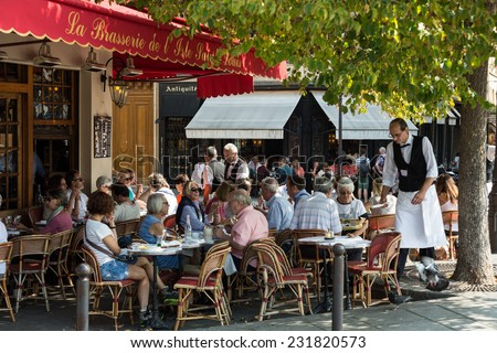 Paris, France - September 9, 2014: : People visit Brasserie de l'Isle Saint-Louis on September 9 2014 in Paris. This is the typical Parisian cafe - stock photo