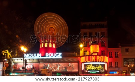 PARIS, FRANCE - 6 SEPTEMBER, 2014: The Moulin Rouge by night, on September 6, 2014 in Paris, France. Moulin Rouge is a famous cabaret built in 1889, located in the Paris red-light district of Pigalle. - stock photo