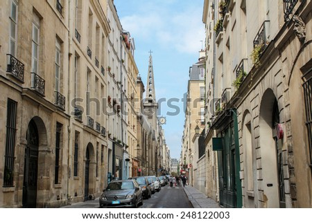 PARIS, FRANCE - SEPTEMBER 02, 2012: Typical apartment buildings at the quay of the river Seine in Paris, capital of France - stock photo