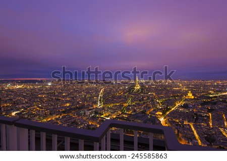 PARIS, FRANCE - SEPTEMBER 21, 2011: view of Paris city and Tour Eiffel illuminated in the night. The Eiffel Tower is the most famous monument in Paris. Night photo taken from the Montparnasse Tower.  - stock photo