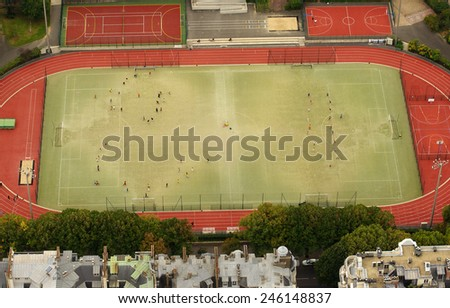 PARIS, FRANCE- SPTEMBER 20, 2011: aerial view of kids training at the Emile Anthoine stadium, view from the Eiffel Tower. Photo taken on September 20, 2011 in Paris.  - stock photo
