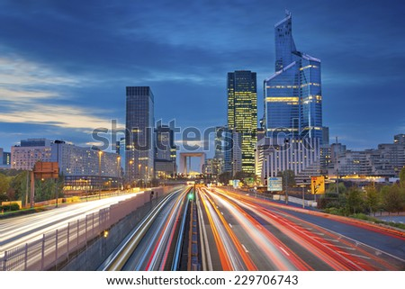 Paris. Image of office buildings in modern part of Paris during twilight. - stock photo
