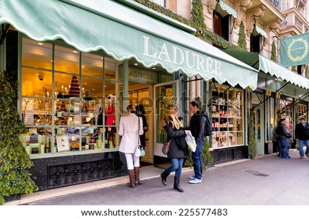 PARIS-JAN 5, 2014: Shoppers at the famous Laduree bakery and tea room in Paris. Laduree was founded in 1862 and is a luxury brand known for its macaroon cookies in many flavors and colors - stock photo