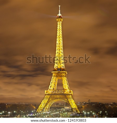 PARIS - JANUARY 1: Eiffel Tower (Tour Eiffel) on January 1, 2012 in Paris. The Eiffel Tower is brightly illuminated shortly after midnight to welcome the New Year. - stock photo