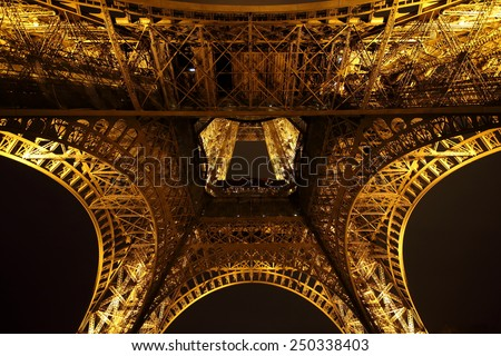 PARIS - JANUARY 31, 2015: Illuminated Eiffel tower at night on January 31, 2015 in Paris. The Eiffel tower is the most visited monument of France. - stock photo