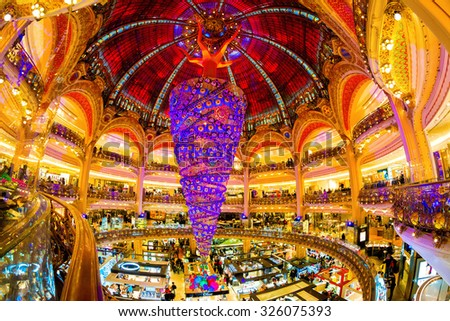 PARIS, JANUARY 3RD, 2015: The unique upside-down Christmas tree at Galeries Lafayette. Galeries Lafayette is an upmarket French department store chain that has been selling luxury goods since 1895. - stock photo