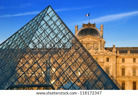 PARIS - JULY 30: Pyramid-entrance and Louvre Palace on July 30, 2012 in Paris, France. The Louvre is one of the world's largest museums, most visited art museum in the world and historic monument. - stock photo