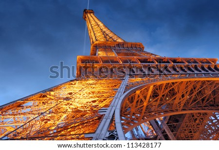 PARIS - JULY 25: The Eiffel Tower from below upwards in the evening on July 25, 2012 in Paris, France. Eiffel Tower is most expensive monument of architecture in Europe, it cost 435 billion euro. - stock photo