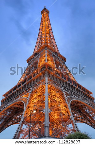 PARIS - JULY 30: The Eiffel Tower from below upwards on July 30, 2012 in Paris, France. Eiffel Tower is lit by more than 350 lamps mounted within the structure of the tower itself. - stock photo