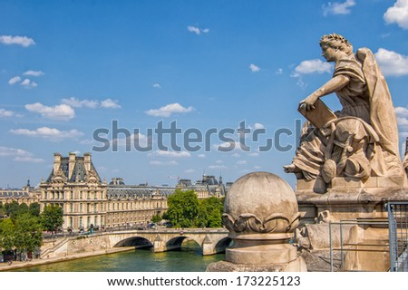 PARIS - JULY 21: The Louvre museum, view from the top of the Musee d'Orsay on July 21, 2013 in Paris, France. The Louvre was once a palace and is now the most famous museum in France. - stock photo