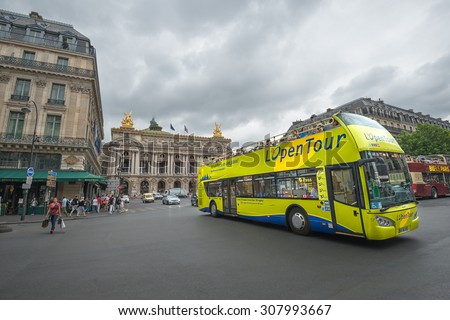 PARIS - JULY 20: Tourists visit the city center on July 20, 2015 in Paris, France. In year 2014 more than 15 million tourists visited the city of Paris. - stock photo