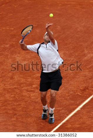 PARIS - JUNE 1: Andy Roddick of USA serves at French Open, Roland Garros on June 1, 2009 in Paris, France. - stock photo