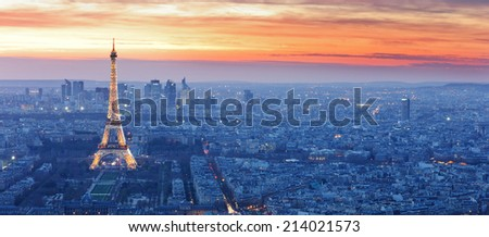 PARIS -JUNE 22: Eiffel Tower brightly illuminated at dusk on June 22, 2013 in Paris. The Eiffel tower is the most visited monument of France. - stock photo