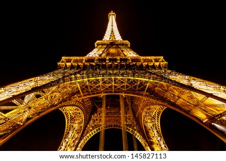 PARIS - JUNE 29: Eiffel Tower light show on June 29, 2013 in Paris, France. Eiffel Tower is the highest and most visited monument in France and use 20,000 light bulbs in the night show. - stock photo