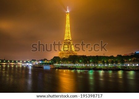 PARIS - JUNE 15: Eiffel Tower on June 22, 2012 in Paris. Eiffel tower is one the most popular attractions in Paris - stock photo