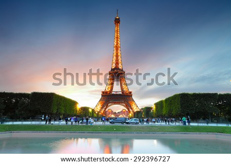 PARIS - JUNE 22, 2015: Eiffel Tower on June 22, 2015 in Paris. Eiffel tower is one the most popular attractions in Paris  - stock photo