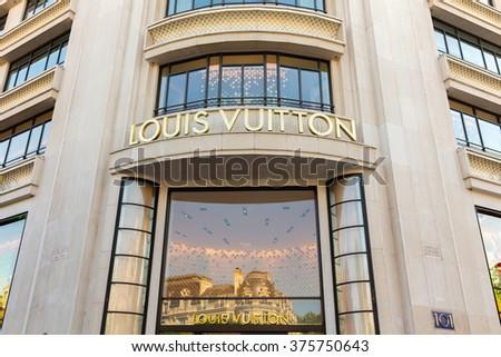 PARIS - JUNE 5: Louis Vuitton shop at Champs-Elysees on JUNE 5,2015 in Paris, France. Louis Vuitton is one of the world's leading international fashion houses. - stock photo