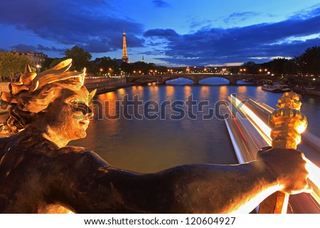 PARIS - JUNE 04: Seine river and Eiffel Tower seen pont Alexandre III on June 4, 2012 in Paris, France. Eiffel Tower is the French most visited monument and use 20,000 light bulbs in the show. - stock photo