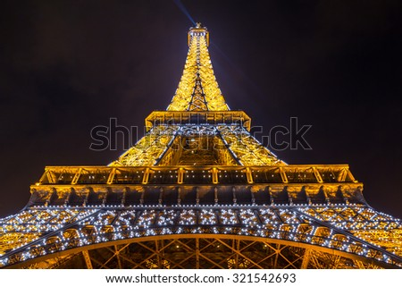 Paris - MAR 14: Eiffel Tower illumination Show on March 14, 2015. Eiffel Tower is the highest monument in France use 20,000 light bulbs in the show. - stock photo