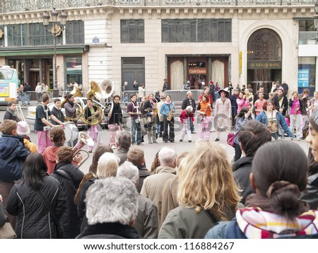 PARIS - MARCH 8 : Amateur musicians performing in front of the Opera, on March 8, 2008, in Paris, France. Is common to find  these cultural expressions in the capital of France. - stock photo