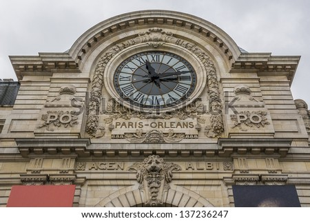 PARIS - MARCH 18: Famous clock in D'Orsay Museum (former Gare d'Orsay - railway station) on March 18, 2013, Paris, France. D'Orsay Museum holds mainly French art dating from 1848 to 1915. - stock photo