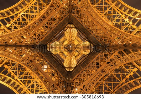PARIS - MARCH 14: The bottom view of the Eiffel tower  on Mar 14, 2015 in Paris. The Eiffel tower is the most visited monument of France. - stock photo